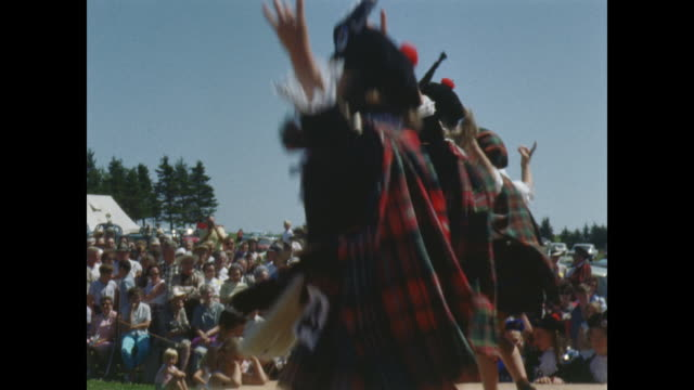 girls in traditional scottish dress perform highland dance on stage. - scottish culture stock videos & royalty-free footage