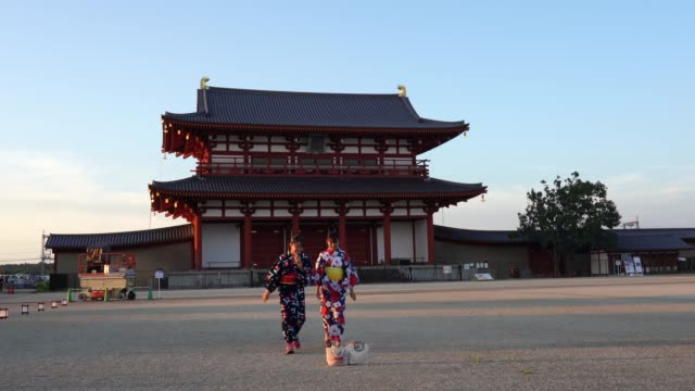 girls in yukata robes take selfies at an annual traditional festivalon august 16, 2020 in nara, japan.the festival has been transformed to a... - yukata robe stock videos & royalty-free footage