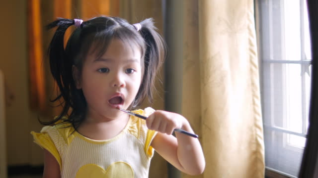 girls is applying lipstick with brush - mouth stock videos and b-roll footage