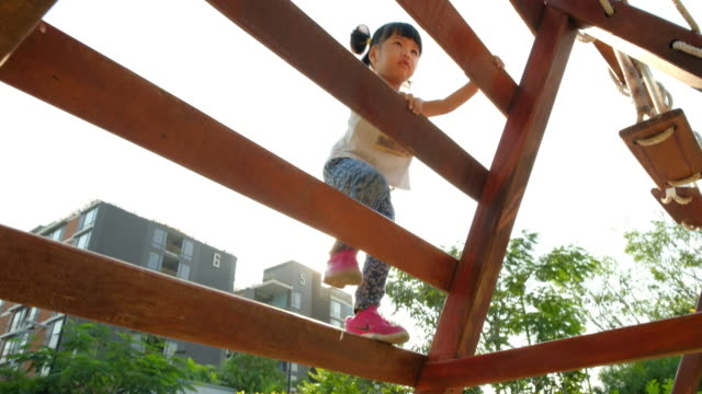 girls is climbing plaything at playground - strength stock videos & royalty-free footage