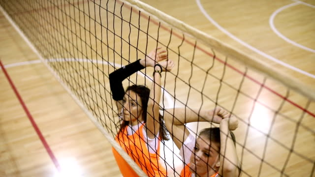 girls jumping in block - volleyball net stock videos & royalty-free footage