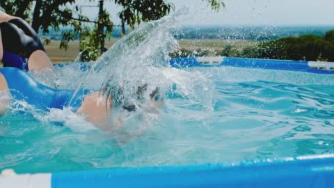 stockvideo's en b-roll-footage met ms girls springen in het zwembad - swimwear