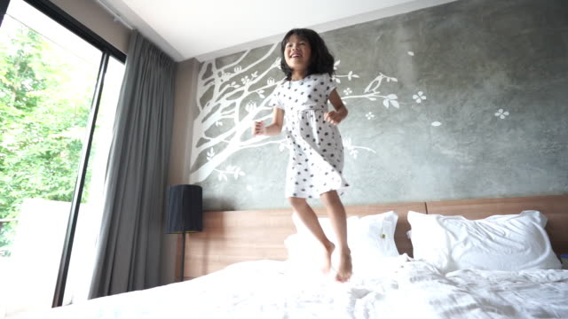 girls jumping on the bed - barefoot stock videos & royalty-free footage