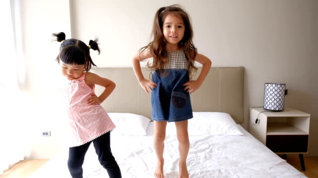 girls jumping on the bed - domestic room stock videos & royalty-free footage