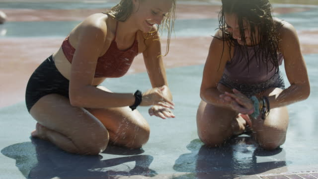 girls kneeling on wet concrete playing clapping game / provo, utah, united states - teenagers only stock videos & royalty-free footage