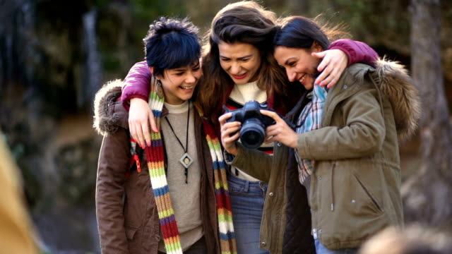 girls laughing at photos they've just taken - photographer stock videos & royalty-free footage