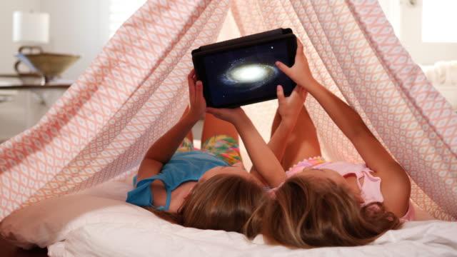 girls looking at digital tablet. - astronaut stock videos & royalty-free footage
