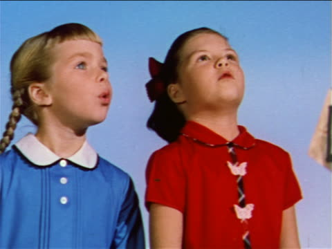 1959 2 girls looking up at something offscreen then looking at each other and shaking heads no - 1950 1959 stock videos & royalty-free footage