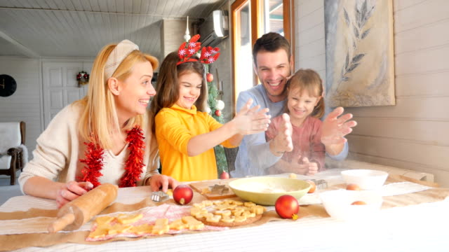 girls making christmas cookies with parents and having fun - moulding trim stock videos & royalty-free footage