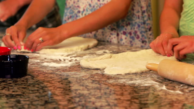 Girls making pizza dough