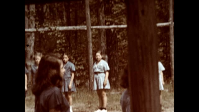girls march and sing at a camp on lake schroon in the adirondacks in the 1940's - bluse stock-videos und b-roll-filmmaterial