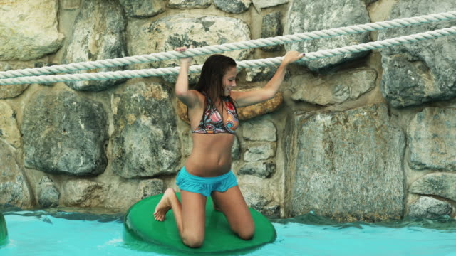 girls on a rope bridge at a water park - 14 15 years stock videos and b-roll footage
