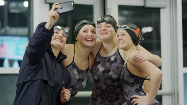 vídeos de stock e filmes b-roll de girls on swimming team posing for cell phone selfie then checking photograph / provo, utah, united states - provo