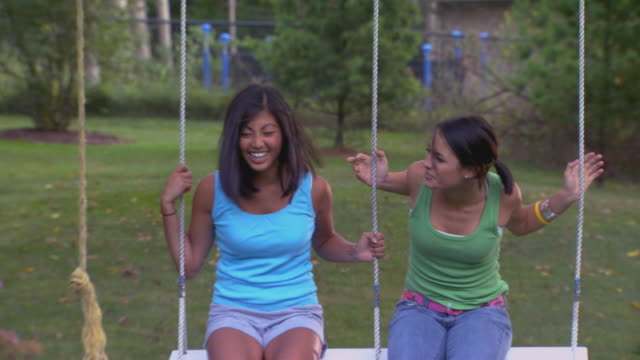 girls on swing - only teenage girls stock videos & royalty-free footage