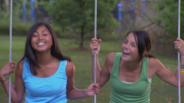 girls on swing - swinging stock videos & royalty-free footage