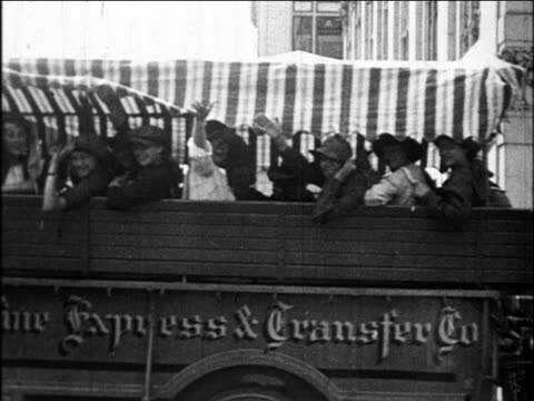 b/w 1922 girls on truck headed for camp waving as they drive by / oakland, california / newsreel - youth organisation stock videos & royalty-free footage