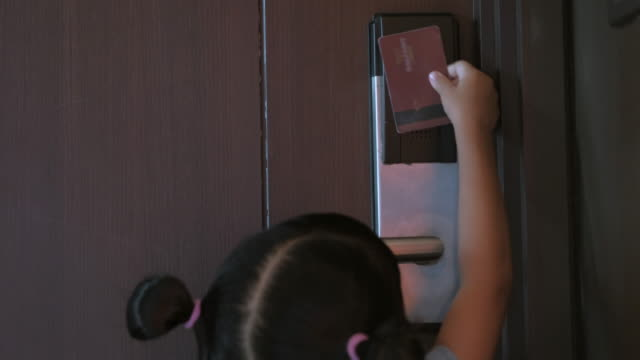 Girls opens the door with electronic key card