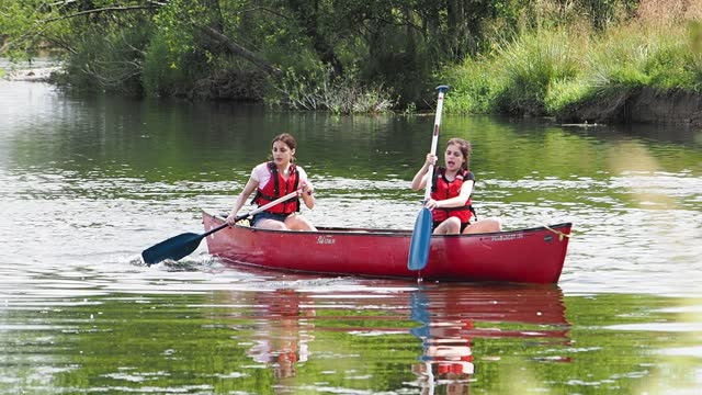 girls paddling and splashing each other in the river brathay in ambleside in a canadian canoe, lake district, on july 19, 2021 in ambleside, uk. - purple stock videos & royalty-free footage
