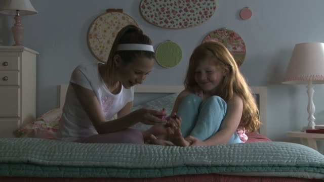 girls painting nails at a sleepover - slumber party stock videos and b-roll footage