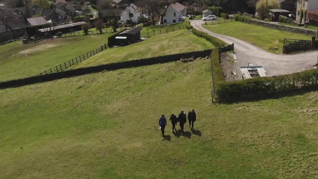 "girls partaking in a duke of edinburgh award scheme hike in the peak district - ""bbc news"" stock-videos und b-roll-filmmaterial"