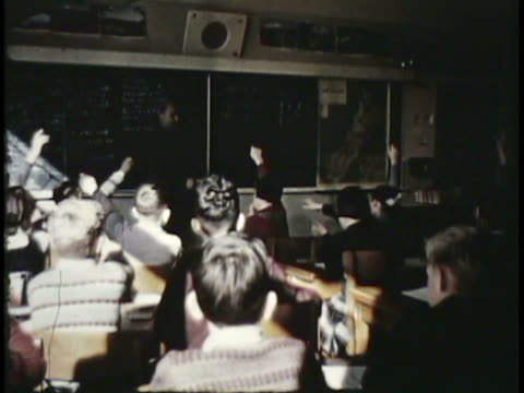 stockvideo's en b-roll-footage met 1955 montage cu ms ws girls passing ball to each other on schoolyard, children learning in classrooms / new zealand / audio - 1955