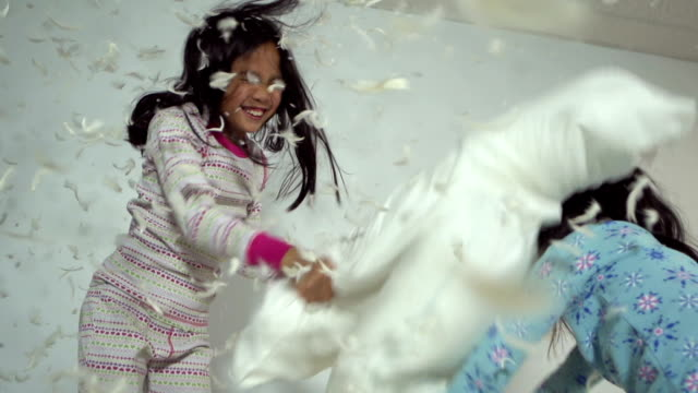 girls pillow fight - bedclothes stock videos & royalty-free footage