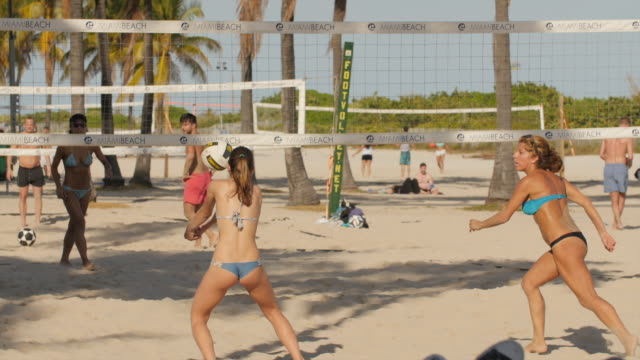 girls playing beach volleyball at miami beach marina - bikini stock videos and b-roll footage