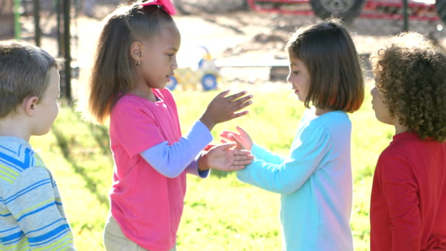 girls playing game on playground, boys watch - playground stock videos & royalty-free footage