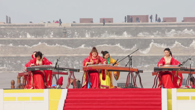 ms girls playing guzheng traditional chinese string instrument audio / xi'an, shaanxi, china - string instrument stock videos and b-roll footage