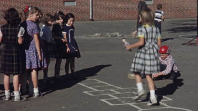 1956 ws girls playing hopscotch / usa - school yard stock videos & royalty-free footage