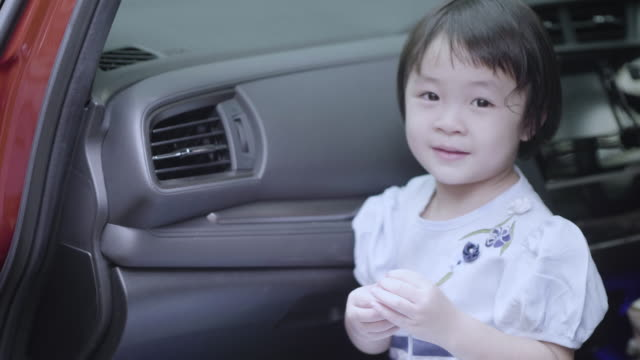 Girls playing in cars