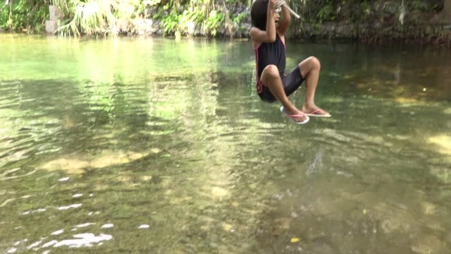 girls playing in the river,okinawa,summer vacation - wet hair stock videos and b-roll footage