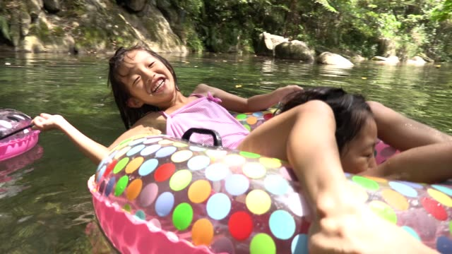 girls playing in the river,okinawa,summer vacation - tubing stock videos and b-roll footage