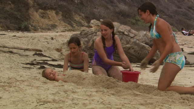 girls playing in the sand - see other clips from this shoot 1156 stock videos & royalty-free footage