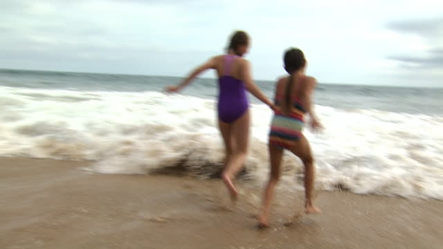 girls playing in the surf - see other clips from this shoot 1156 stock videos & royalty-free footage