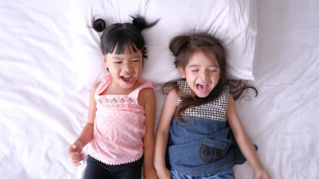 Girls Playing On The Bed
