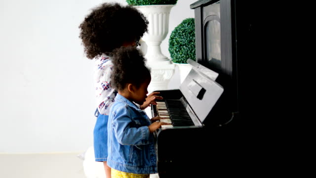 girls playing piano - children only stock videos & royalty-free footage
