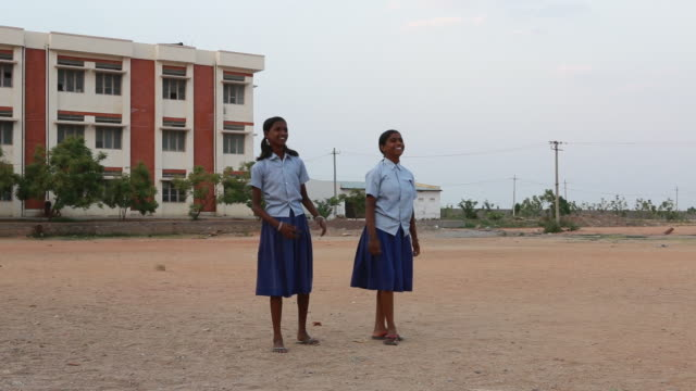 Girls playing volleyball in their school uniforms, near Pannur, India (h264)