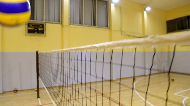 girls playing volleyball - volleyball net stock videos & royalty-free footage