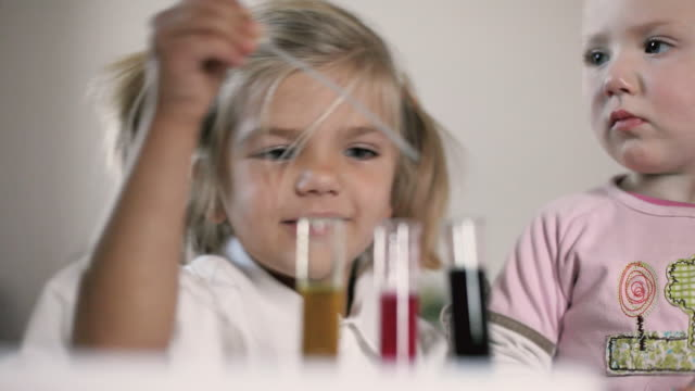 cu girls (12-23 months, 4-5 years) playing with science kit / potsdam, brandenburg, germany - 4 5 years stock videos and b-roll footage