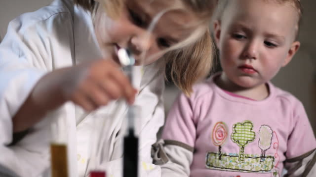 CU R/F Girls (12-23 months, 4-5 years) playing with science kit / Potsdam, Brandenburg, Germany