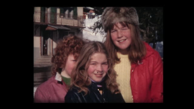 stockvideo's en b-roll-footage met 1971 girls pose for camera - verlegen