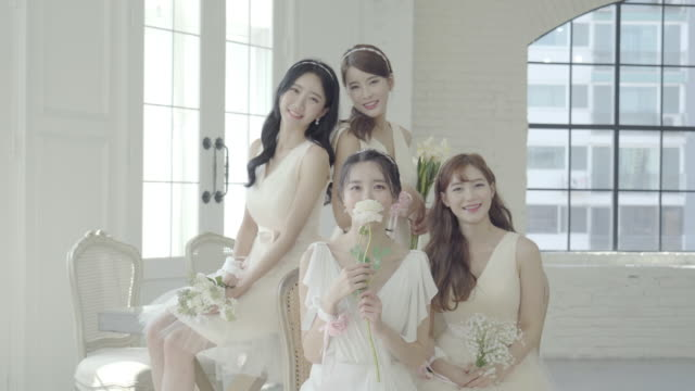 girls posing with flowers at a bridal shower party - 韓国人点の映像素材/bロール