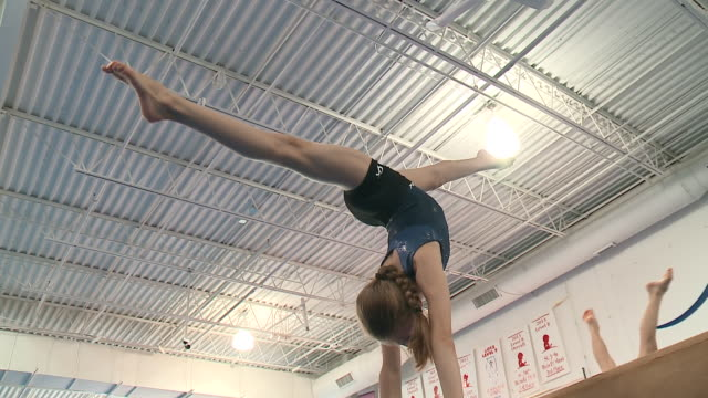 wgn girls practicing gymnastic routines on balance beam in chicago on sept 28 2017 - gymnastics stock videos & royalty-free footage