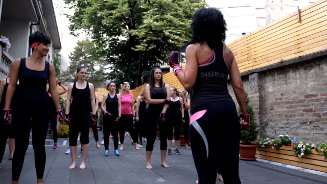 girls preparing for group work out - strongwoman stock videos & royalty-free footage