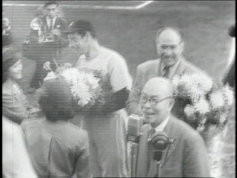 montage girls presenting flowers to joe dimaggio and lefty o'doul at japanese ball park - 1951 stock videos & royalty-free footage