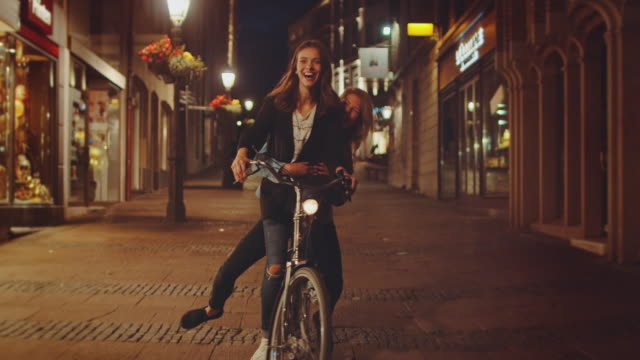 girls riding bike at night - nightlife stock videos and b-roll footage