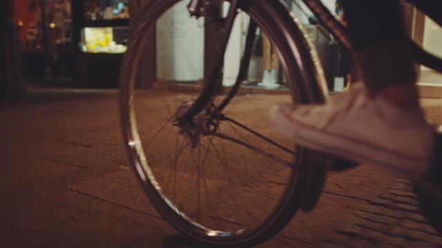 girls riding bike at night - bicicletta video stock e b–roll