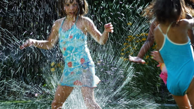 girls running in a sprinkler - see other clips from this shoot 1421 stock videos & royalty-free footage