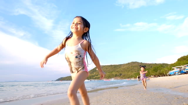 girls running on beach - children only stock videos & royalty-free footage
